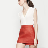 Maje Leather-look fabric trompe-l'oeil shorts