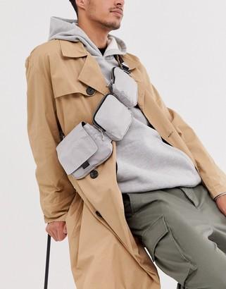 Asos multi pocket cross body bag in silver