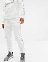 Criminal Damage skinny sweatpants in white with check side stripe