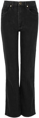 KHAITE Vivian Faded Black Bootcut Jeans