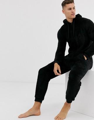 Asos Design DESIGN hooded lounge fleece onesie in black