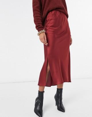 ASOS DESIGN bias cut satin midi skirt in burgundy