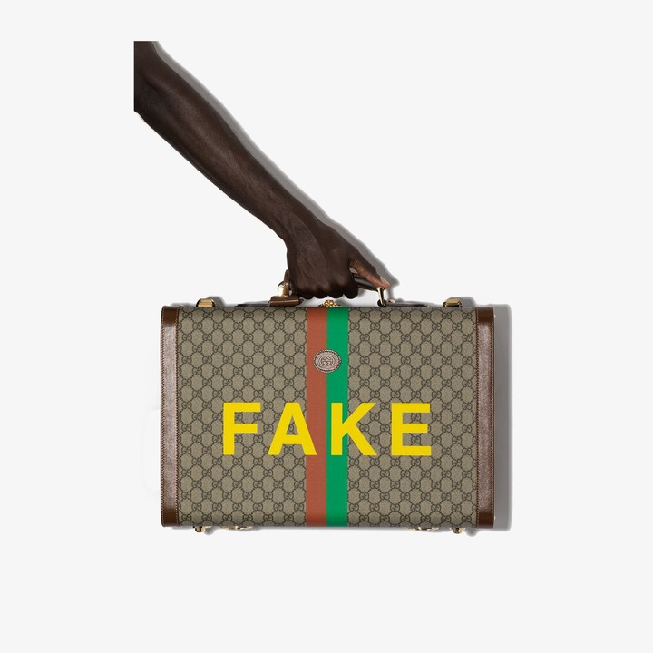 Gucci Fake/Not' print medium suitcase