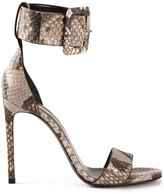 uncategorized  Who made Jessie Js brown jumpsuit and snake ankle strap sandals?