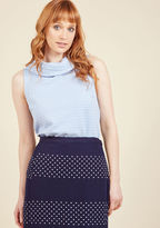 110306A Rival the intrigue of the gallery opening by making an appearance in this pastel purple top. Textured to perfection, glittering with an exposed back zipper, and complete with an ultra chic foldover collar, this sleeveless number creates stiff competition