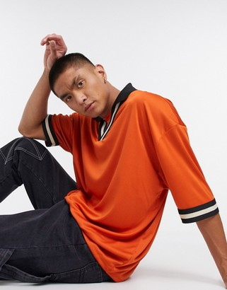 ASOS DESIGN oversized polo shirt with retro neck tipping in high shine fabric