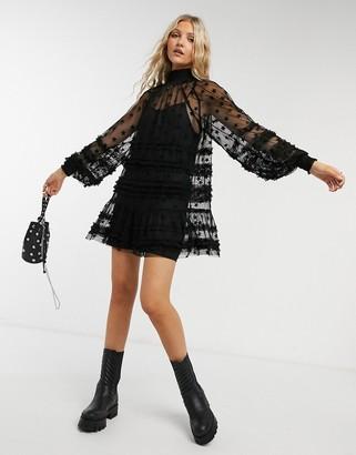 Topshop mesh mini dress in black star print