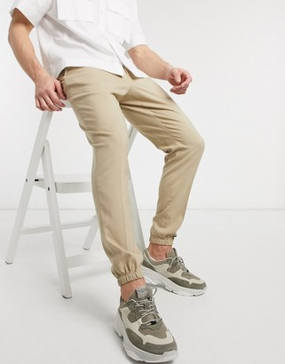 ASOS DESIGN smart skinny pants with jogger cuffs in stone