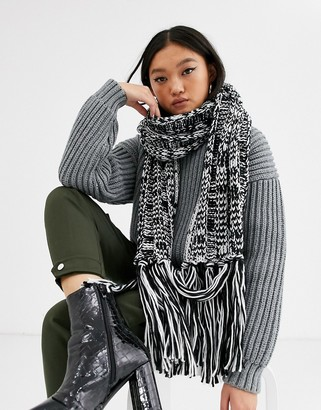 Asos Design DESIGN two tone knit scarf with tassels in black and white