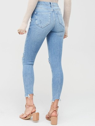River Island Ripped Molly Mid Rise Jeggings - Light Blue