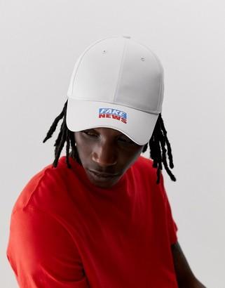 Asos Design DESIGN baseball cap in white with 'fake news' print