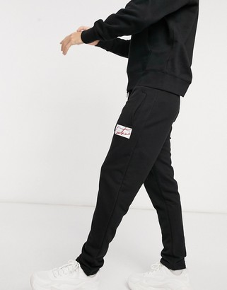 The Couture Club archive box tapered track pants T-shirt in black