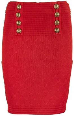 Balmain High-waisted double-buttoned red knit skirt
