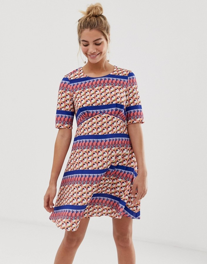 Yumi empire line dress in stripe geo print