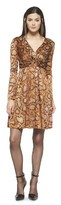 uncategorized  Who made  Naomie Harris snake print brown dress that she wore in New York?