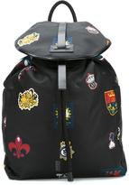 Alexander McQueen badge print backpack - men - Leather/Nylon - One Size