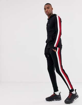Asos Design DESIGN tracksuit muscle hoodie/super skinny sweatpants in black with side stripe