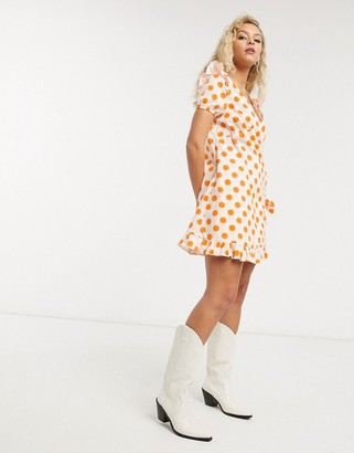 Lost Ink wrap front smock mini dress in tonal polka dot