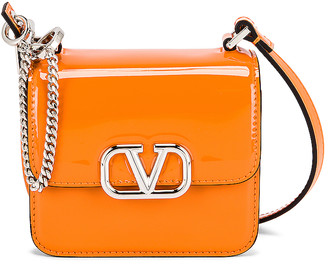 Valentino Micro VSling Shoulder Bag in Pale Apricot | FWRD