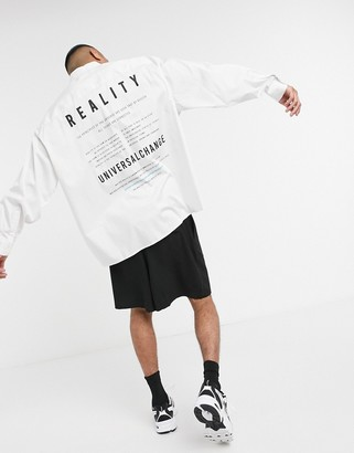 ASOS DESIGN oversize wide shirt in white with reality text back print