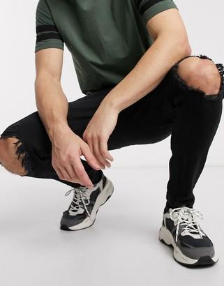 Bershka carrot fit jeans in black