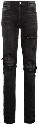 Amiri slim-fit distressed cotton and leather jeans