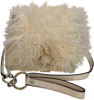 Diane von Furstenberg White Fur Handbags
