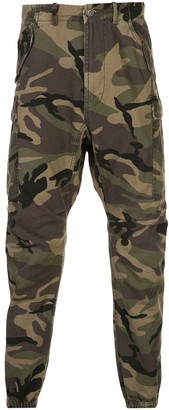 R 13 tapered camouflage print trousers