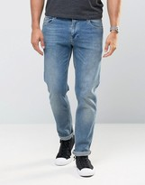 Asos Stretch Slim Jeans In Mid Wash Blue