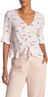 Elodie K Elbow Length Ruffle Sleeve Cinched Blouse