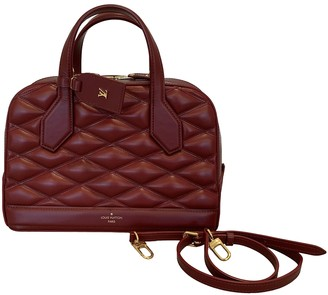 Louis Vuitton Dora Burgundy Leather Handbags