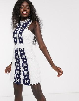 Chi Chi London mini pencil dress in navy colour block lace