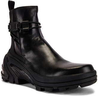 Alyx Low Buckle Boot With Fixed Sole in Black | FWRD