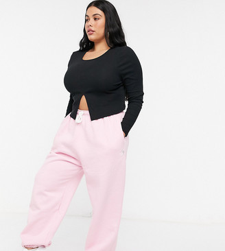 Daisy Street Plus relaxed trackies with yin yang embroidery in pastel co-ord