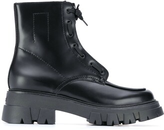 Ash Lynch front zip chunky boots