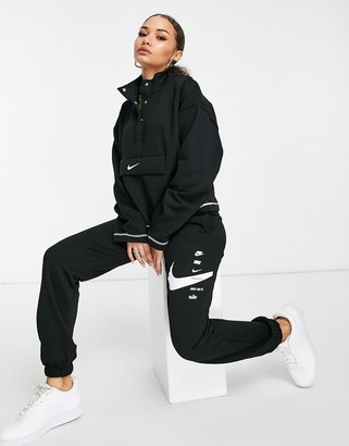 Nike swoosh oversized joggers in black