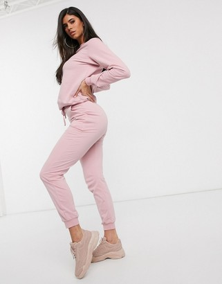 Asos Design DESIGN tracksuit ultimate sweat / jogger with tie-Pink