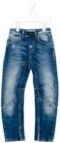 John Galliano twisted faded jeans