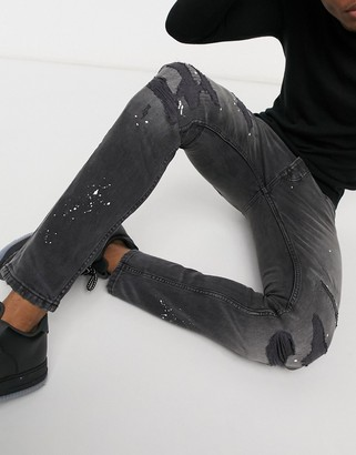Topman skinny jeans with paint splatter in vintage washed black