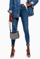 Topshop Mid Blue Ripped Hem Jamie Skinny Jeans