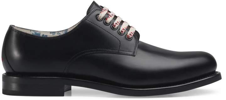 Gucci Black leather lace-up shoe