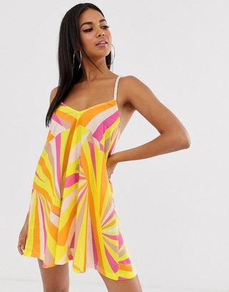 Asos DESIGN jersey beach sundress with rope tie in faded fluro stripe print with natural flash