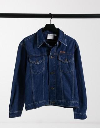 Calvin Klein EST 1978 denim trucker jacket in dark wash blue