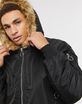 The Couture Club Dakota faux fur lined bomber jacket in black