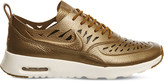 Nike Thea cutout metallic leather trainers