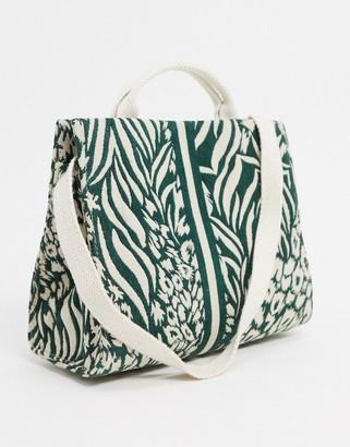 Accessorize graphic print tote bag with cross body strap in cream