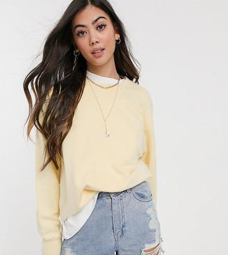 Asos DESIGN Petite oversized washed sweatshirt in lemon