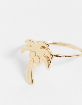 ASOS DESIGN thumb ring with palm tree design in gold tone
