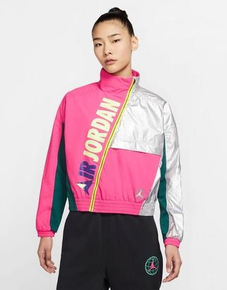 Jordan Nike Urban MTN logo jacket in pink/reflective silver