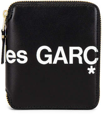 Comme des Garcons Huge Logo Wallet in Black | FWRD